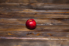 Red apple on a wooden background Royalty Free Stock Photos