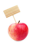 Red apple and wooden label Royalty Free Stock Photography