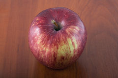 Red apple on a wooden table Stock Images