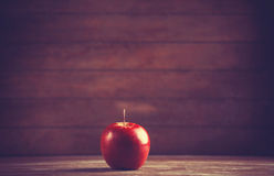 Red apple on wooden table Royalty Free Stock Photography