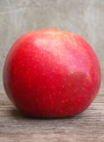 Red apple on wooden table Royalty Free Stock Images