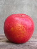 Red apple on wooden table Royalty Free Stock Photos