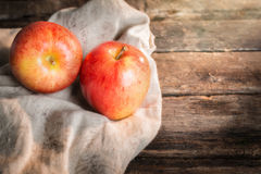 Red apple on wooden table sunshine light Royalty Free Stock Photos