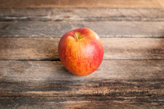 Red apple on wooden table sunshine light Stock Photography