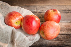 Red apple on wooden table sunshine light Royalty Free Stock Image