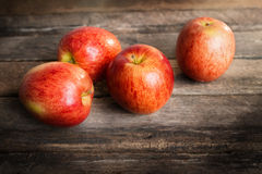 Red apple on wooden table sunshine light Royalty Free Stock Photography