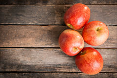 Red apple on wooden table sunshine light Royalty Free Stock Photo