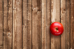 Red apple on wooden table Stock Image