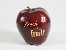 Red apple with the words - fresh and fruity - Stock Images