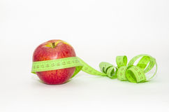 Red apple wrapped in centimeter Stock Photography