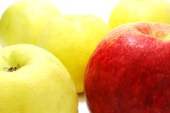 Red Apple between Yellow Royalty Free Stock Photos