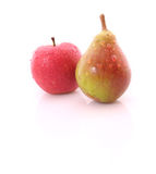 Red apple and yellow-green pear Royalty Free Stock Photos