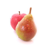 Red apple and yellow-green pear Royalty Free Stock Image