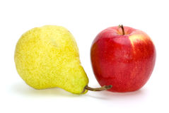 Red apple and yellow-green pear Royalty Free Stock Photography