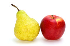 Red apple and yellow-green pear Stock Photos