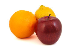 Red apple, yellow lemon and an orange Stock Image