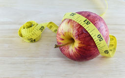 Red apple and yellow measuring tape concept for healthy diet and Stock Photo
