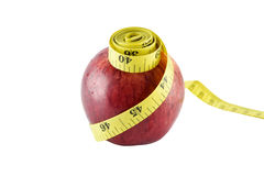 Red apple and yellow measuring tape concept for healthy diet and Stock Photography