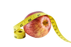 Red apple and yellow measuring tape concept for healthy diet and Royalty Free Stock Image