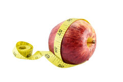 Red apple and yellow measuring tape concept for healthy diet and Royalty Free Stock Photography