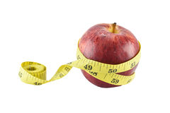 Red apple and yellow measuring tape concept for healthy diet and Stock Images