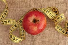 Red Apple and Yellow Measuring Tape Stock Photography