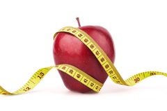 Red apple with yellow measuring tape Stock Photography