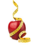 Red apple with yellow measuring tape Stock Images