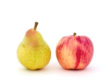 Red apple & yellow pear. On the white background royalty free stock photos