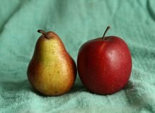 Red apple and yellow pear as an art still life for painting. Lesson in school royalty free stock photography