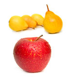 Red apple and yellow pears Stock Photography