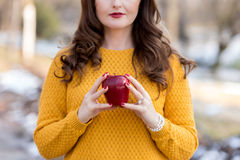 Red apple. Young woman holding a red apple in her hands Royalty Free Stock Photography