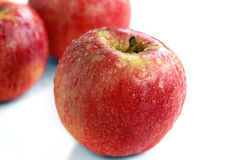 Red apples. The red ripe apples covered with drops of water Royalty Free Stock Images