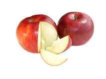 Red apples. With two cut off slices on a white background Royalty Free Stock Photos