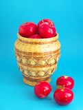 Red apples. Still life red apples in wicker and scattered on blue background Royalty Free Stock Photo