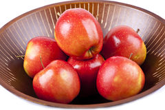 Red apples. On dish, isolated on the white background Stock Photo