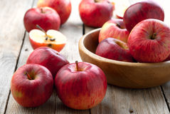 Red Apples. A bowl of red apples on the wooden table Royalty Free Stock Images