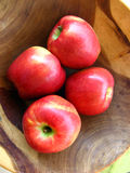 Red apples. Inside a wooden bowl macro Stock Photography