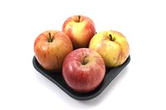 Red Apples. Fresh red apples brightly lit on isolated white background stock image