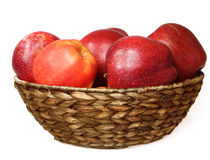 Red apples. In a wicker plate Royalty Free Stock Photos