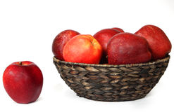 Red apples. In a wicker plate stock photo
