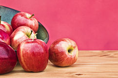 Red apples. Spilling from a bowl with room for copyspace Stock Image
