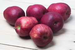 Red Apples. Red apple on wooden background Royalty Free Stock Photos