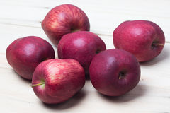 Red Apples. Red apple on wooden background Stock Photo