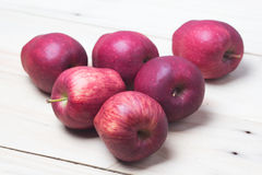 Red Apples. Red apple on wooden background Royalty Free Stock Images