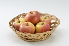 Red apples in a basket. Royalty Free Stock Photos