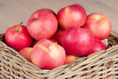 Red apples in basket Stock Photography