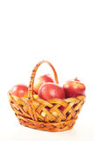 Red apples in a basket isolate Royalty Free Stock Images