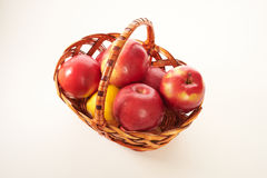 Red apples in a basket isolate Stock Photos
