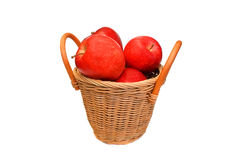 Red apples in a basket are isolated on a white. Red apples in a wattled basket are isolated on a white background Royalty Free Stock Photo